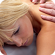 White blond woman receiving a back massage.